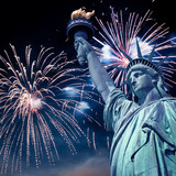 Statue of Liberty at night with fireworks, New York, USA