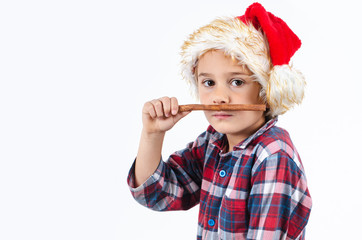 Kleiner Weihnachtsmann mit Zimtstange