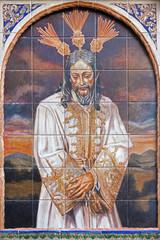 Seville - ceramic tiled Christ in the bond on San Juan church
