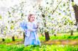 Little girl in apple garden