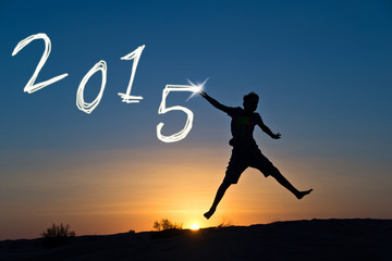 2015 Silhouette of a boy jumping in the sun