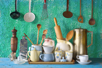 collection of vintage kitchenware, green background