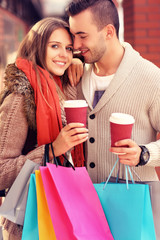 Happy couple with coffee shopping in the mall