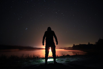 night man at Lake starry sky space alien