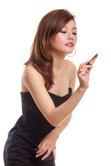 Attractive Asian woman writing with lipstick