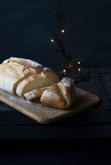 white bread on a dark background and Christmas garland