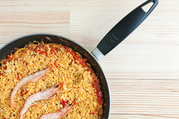 Spanish rice or paella with prawns and fish