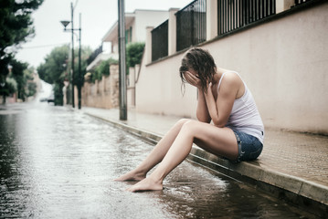 Sad woman crying on the street.