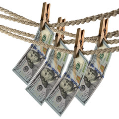 Dollar bill is hanging on a rope with wooden clothespin. Isolate