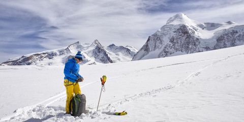 Lonely man with ski in alpine landscape