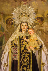 Seville -  statue of traditional Madonna in Buen Suceso church