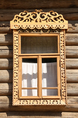 Old window of russian wooden house