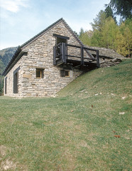 exterior view of a stone houe in mountain, Itlay