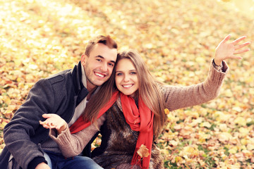 Happy couple relaxing in the autumn park