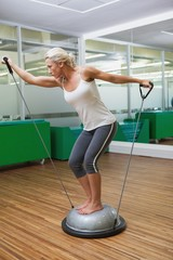 Woman doing fitness exercise in fitness studio