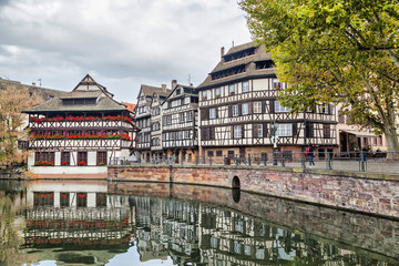Traditional half-timbered houses reflecting in water, Strasbourg