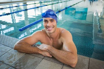 Portrait of swimmer in pool at leisure center