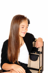 Smiling girl in briefcase.