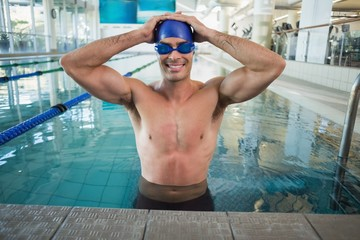 Fit swimmer in the pool at leisure center