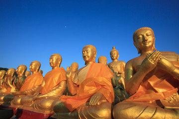 golden buddha statue in temple with beautiful morning light agai