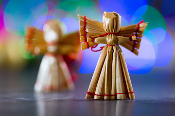Christmas angel on a background of colored bokeh