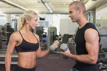 Strong couple lifting hand weights together