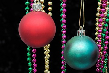 Red and green plastic Christmas baubles © Arena Photo UK
