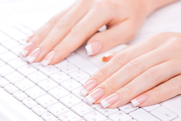 Hands of an office woman typing
