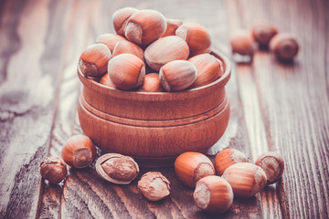 hazelnuts in the bowl on a wooden table
