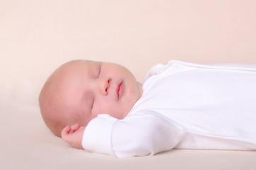 Little newborn baby boy sleeps