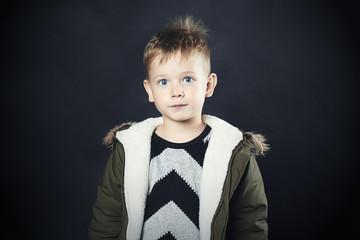 funny child in winter coat. fashion kids.children.shaggy
