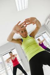 Females In Gym Stretching