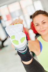 Female In Gym Stretching