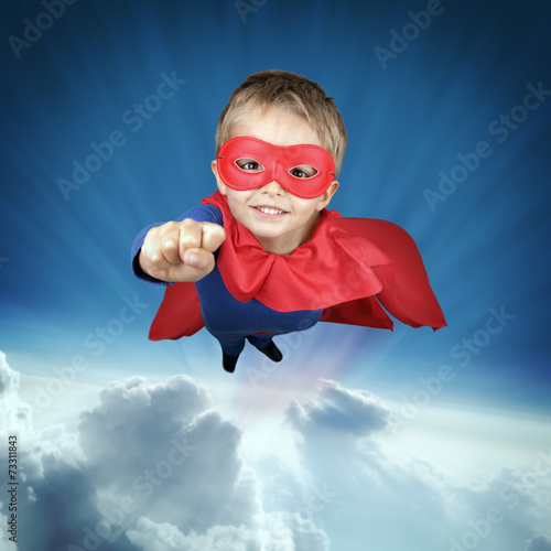 Superhero child flying above the clouds Poster