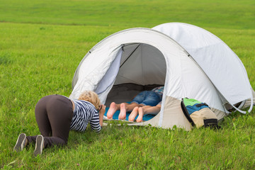 woman photographs a boy and girl in the tourist tent
