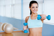 Exercising with dumbbells.