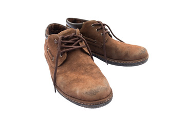 Old brown shoes on white background