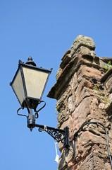 Iron lantern on stone wall © Arena Photo UK