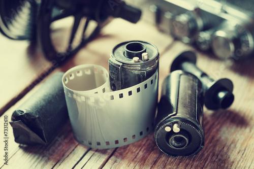 Old photo film rolls, cassette and retro camera. - 73312610