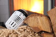 Leinwandbild Motiv Ofen mit Thermostat und Holz