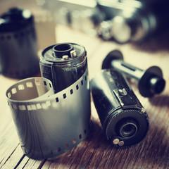 Old photo film rolls, cassette and retro camera.