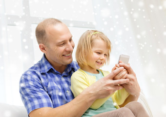 happy father and daughter with smartphone