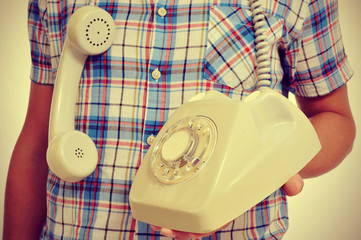 young man with a rotary dial telephone, with a retro effect