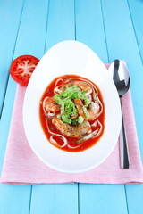 Fresh prawns with spaghetti and lettuce in tomato sauce in a