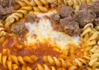 Freshly cooked Italian sausage with pasta