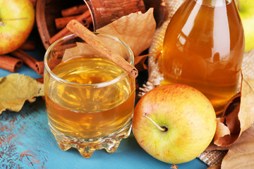 Composition of  apple cider with cinnamon sticks, fresh apples