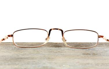 Eye glasses on table on white background