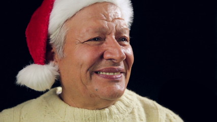 Happy Aged Man Offering A Small Red Wrapped Gift