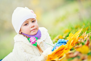 little girl in autumn forest, yellow leaves and little girl