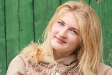 Portrait of green-eyed blond hair girl